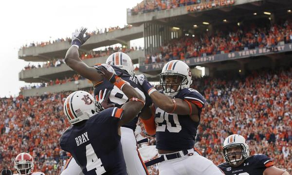 Auburn running back Corey Grant, right, celebrates with teammates Quan Bray, left, and Melvin Ray after scoring a touchdown in Saturday's 43-38 win over Georgia. The Tigers still have a chance of making the BCS title game heading into their showdown with top-ranked Alabama on Nov. 30.