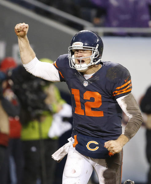 Bears quarterback Josh McCown runs to the sidelines after a Matt Forte touchdown in the fourth quarter.