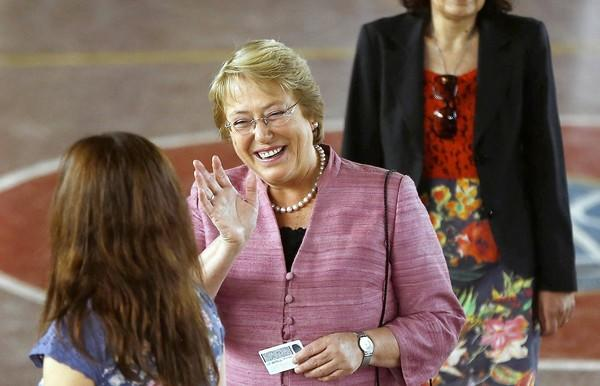 Chilean presidential candidate Michelle Bachelet waves before casting her vote in Santiago.