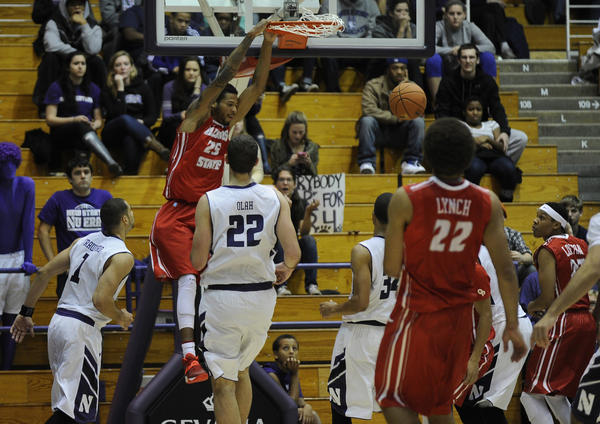 Illinois State's Michael Middlebrooks dunks over Northwestern defenders during the first half.