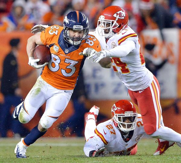 The Broncos' Wes Welker picks up a first down past the Chiefs' Brandon Flowers and Sean Smith.
