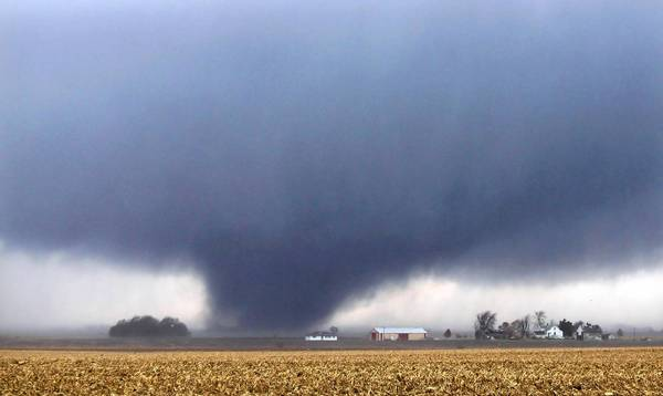 A tornado near Flatville, Ill., about 90 miles southeast of Peoria. At least six people were killed and dozens injured in a rare November outbreak of tornadoes in the Midwest.