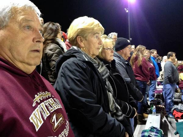 Longtime Whitehall football fans (from left) Joe Bonshak, Betty Jane Bonshak, Carol Buskirk and Jake Buskirk have been sitting together for years. They are standing for the Whitehall alma mater before Friday's District 11 4A playoff game against Parkland.