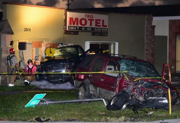 Investigators from the Broward Sheriff's Office and other nearby agencies were investigating a pre-dawn crash in West Park along State Road 7 on Monday, Nov. 18, 2013 involving two vehicles that landed on the property of the Trio Motel, 2501 State Road 7.