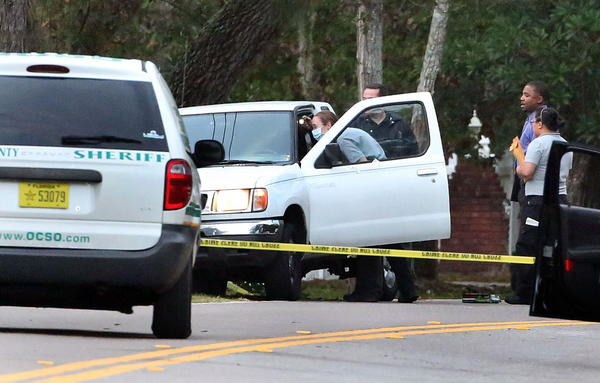 Law enforcement agencies investigate a crime scene Monday, November 18, 2013 after a Florida Highway Patrol Trooper was involved in a shooting that ended at Lake Pickett Road and Tanner Road in East Orange County. (Red Huber/Staff Photographer)