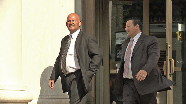 Ray Soucy, left, walks out of New Haven Federal Court in July with his attorney Steven Rasile.