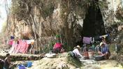 Philippine typhoon survivors turn cave-dwellers