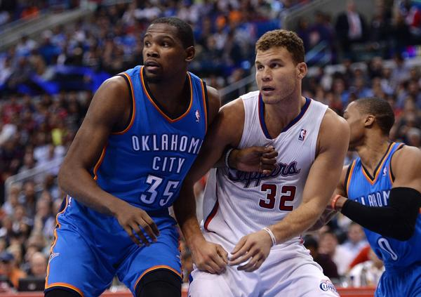 Clippers' Blake Griffin, right, takes on Oklahoma City's Kevin Durant at Staples Center.