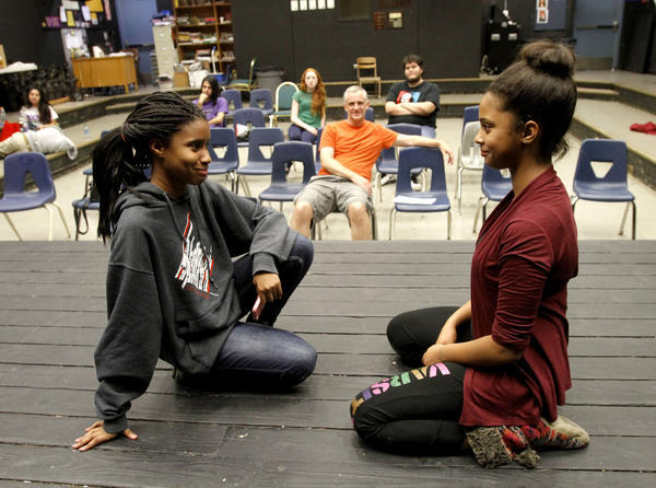 Hoover High School 9th grader Vivica Rush, left, and 10th grader Sabrina Taylor, right, perform at the school's drama room in the 18th hour of a 24-hour improv marathon on Saturday, Nov. 16, 2013. Drama teacher Dave Huber oversees the acting at background center.