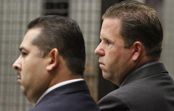 Former Fullerton police officers Manuel Anthony Ramos (left) and Jay Patrick Cicinelli in court in 2012.