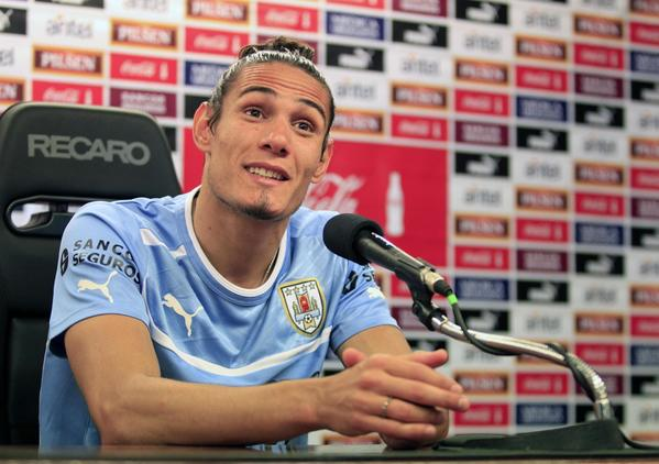 Uruguay's national soccer team player Edinson Cavani speaks to the media during a news conference after a soccer training session at the team's headquarters on the outskirts of Montevideo November 18, 2013. Uruguay will play Jordan in their World Cup qualifying playoff second leg soccer match in Montevideo on Wednesday. REUTERS/Andres Stapff (URUGUAY - Tags: SPORT SOCCER WORLD CUP) ORG XMIT: AST06