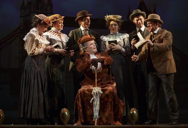 "Jefferson Mays, seated center, with the cast during a performance of ""A Gentleman's Guide to Love and Murder, "" at the Walter Kerr Theatre in New York."