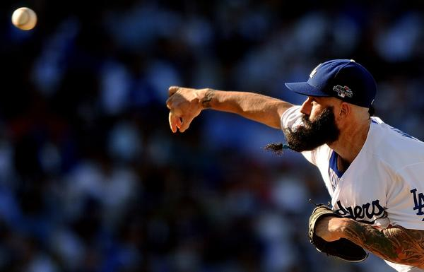 Dodgers reliever Brian Wilson won't give up his famous facial hair to join the deep-pocketed New York Yankees.