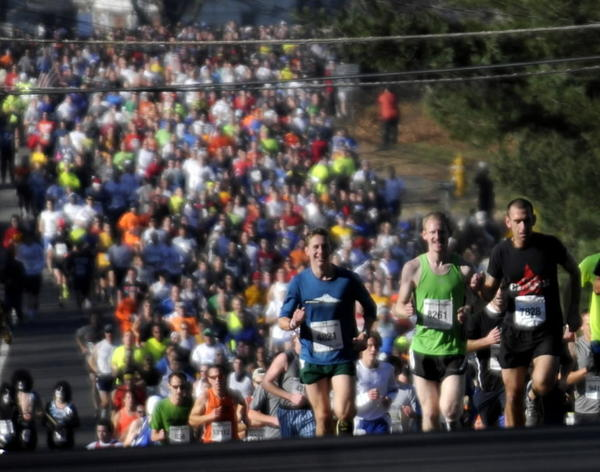The crowd of runners crest the hill at the two-mile mark of the 76th Manchester Road Race last year. More than 15,000 runners participated.