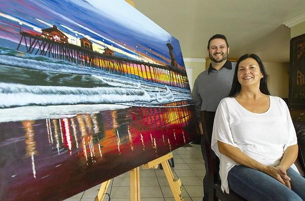 Artist Chris Meredith was commissioned by Luanne Diehl to paint a scene from the Huntington Beach Pier.