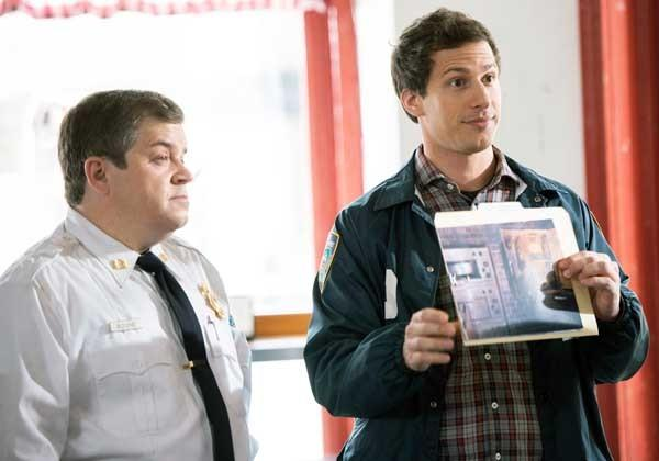 "Fire Marshal Boone (Patton Oswalt, left) has an arson suspect on ""Brooklyn Nine-Nine."" With Andy Samberg."