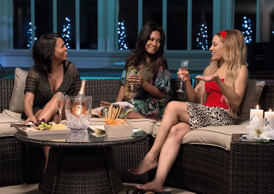 "From left, Nia Long as Jordan, Monica Calhoun as Mia and Melissa De Sousa as Shelby share stories in the movie ""The Best Man Holiday."""