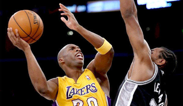Lakers guard Jodie Meeks, trying to score over Spurs forward Kawhi Leonard during a game earlier this month, came into the season with career accuracy of 40.4% overall, 36.7% from three-point range.