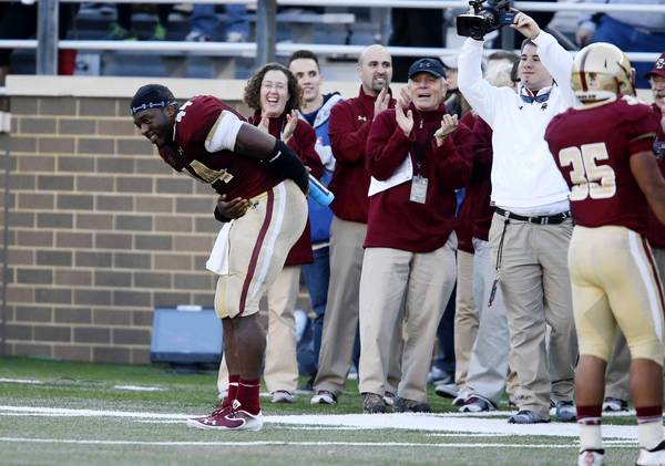 Parkland grad Andre Williams of Boston College takes a bow after it was announced he had broken the school's single season rushing record on Saturday.