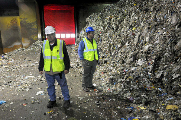 HARTFORD, CT - 11.18.2013 - CRRA - Operations engineer Gary Bonafilia (from left) and public affairs director Paul Nonnenmacher give a tour of the waste processing facility at the CRRA (Connecticut Resource Recovery Authority) trash-to-energy plant on Maxim Road in Hartford. The facility receives 2,000 to 2,500 tons of trash a day. The tip floor, where trucks unload their trash, has a capacity of about 7,000 tons. The garbage is then separated, shredded and incinerated. CRRA will submit a transition plan at the Nov. 19 DEEP Resource Recovery Task Force meeting, after an audit of the quasi-public agency concluded that the business model isn't working and major changes are necessary to keep it running. The agency makes up a large chunk of the state's trash to energy system, which handles two-thirds of Connecticut's solid waste. PATRICK RAYCRAFT | praycraft@courant.com