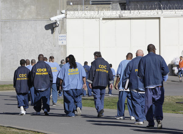 Inmates at California State Prison Sacramento, where authorities say a prisoner slashed a guard in the neck Monday.