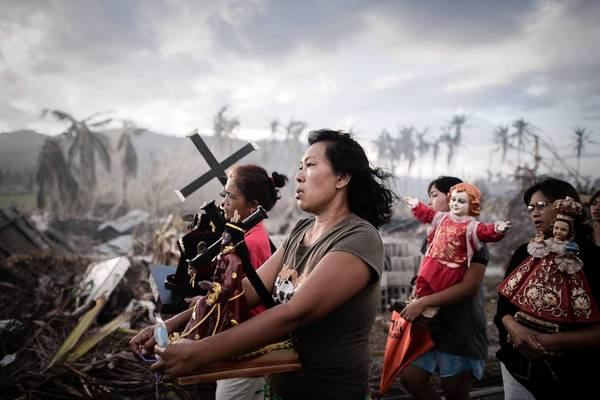 Filipinos walk in a religious procession in Tolosa, about 20 miles south of Tacloban on the island of Leyte, more than a week after Typhoon Haiyan devastated the area.