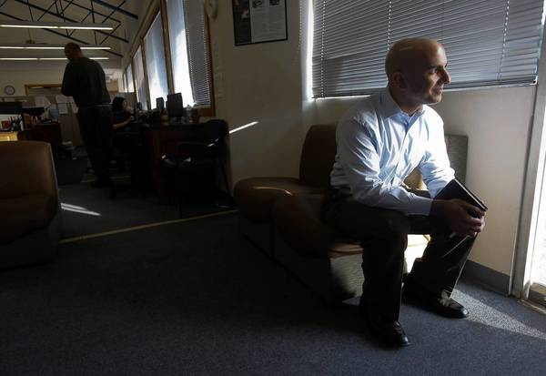Former Goldman Sachs banker and Treasury Department official Neel Kashkari listens to the stories of homeless clients at the Illumination Foundation in Stanton on Friday. He's mulling a run for governor next year.