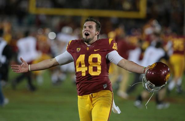 USC kicker Andre Heidari celebrates after the Trojans' 20-17 upset win over Stanford at the Coliseum on Saturday.