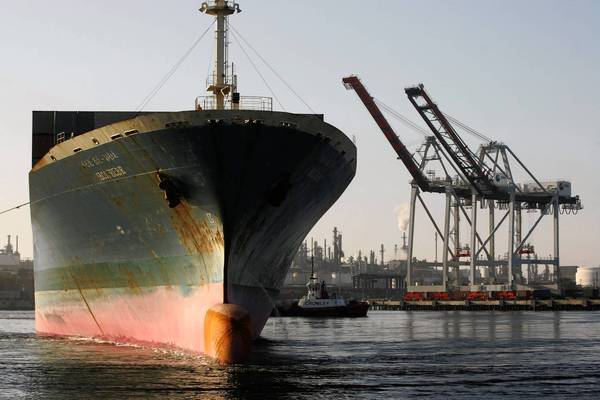 The Japanese cargo ship Mol Elbe leaves the TraPac Terminal at the Port of Los Angeles.