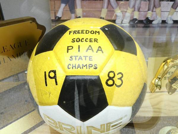 The trophy case at Freedom High School holds hardware won by the 1983 soccer team including the East Penn Conference championship, District 11 championship and PIAA championship.