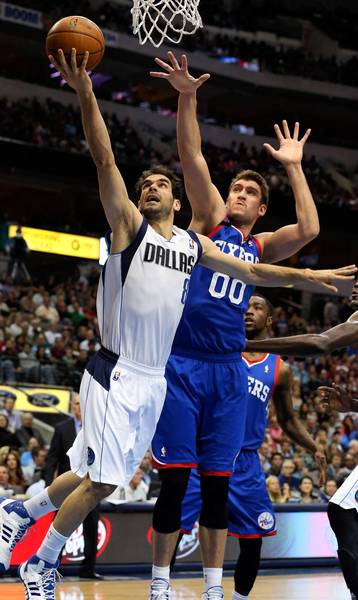 Jose Calderon (8) of the Mavericks drives to the basket in front of Spencer Hawes of the 76ers during the second period at the American Airlines Center in Dallas on Monday.