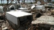 Philippines typhoon rips bodies from graves