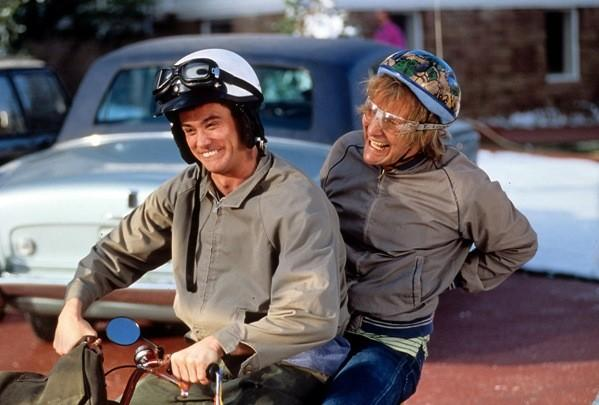 Jim Carrey and Jeff Daniels riding bike in a scene from the film 'Dumb & Dumber', 1994.