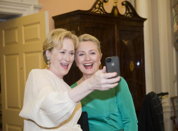 Actress Meryl Streep uses her iPhone to take a selfie of her and then-Secretary of State Hillary Rodham Clinton following a gala in Washington.