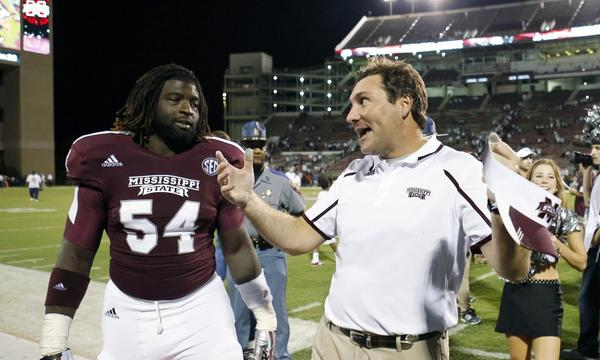 Mississippi State Coach Dan Mullen, right, celebrates with defensive lineman Quay Evans following a 62-7 win over Troy in September.