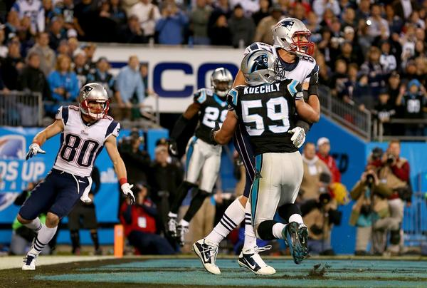 CHARLOTTE, NC - NOVEMBER 18: Rob Gronkowski #87 of the New England Patriots and Luke Kuechly #59 of the Carolina Panthers fight for the ball in the end zone on the last play of the game at Bank of America Stadium on November 18, 2013 in Charlotte, North Carolina. (Photo by Streeter Lecka/Getty Images) ***BESTPIX*** ORG XMIT: 184892950