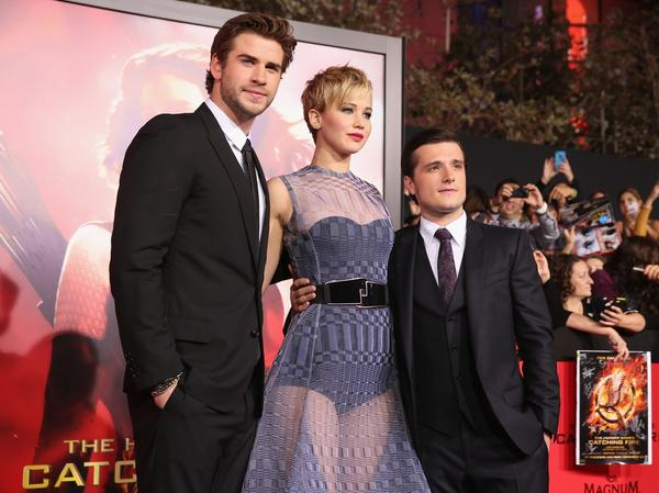 (L-R) Actors Liam Hemsworth, Jennifer Lawrence and Josh Hutcherson.