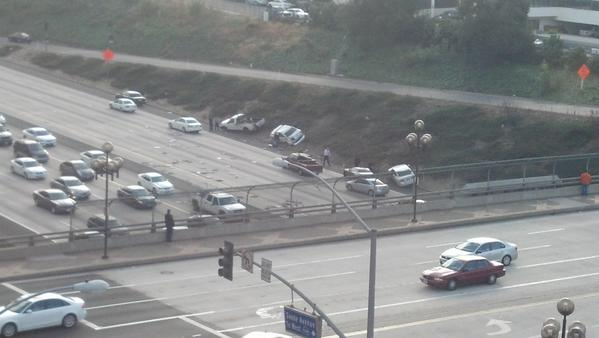 The multi-vehicle crash, which involved a semi-truck, sent two cars up on an embankment beside the freeway.