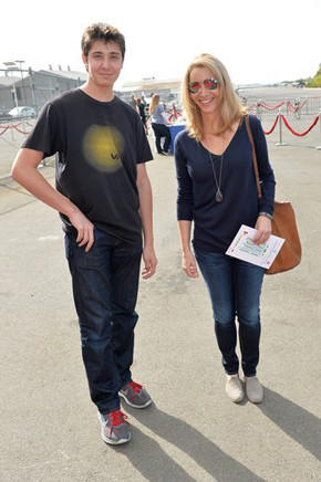 "Actress Lisa Kudrow and son Julian Murray Stern attend the P.S. Arts ""Express Yourself 2013"" event at Barker Hangar on Sunday."