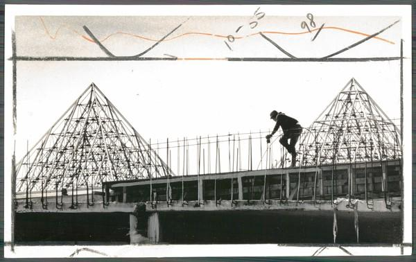 With the pyramid skylights in the background, a worker finds himself alone during construction of the Columbia mall. The picture was taken five months before the mall's opening.