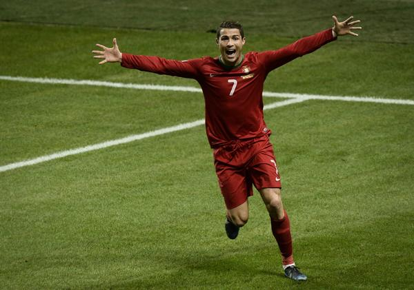 Portugal's Cristiano Ronaldo celebrates after scoring the 2-3 at the Friends Arena in Solna, near Stockholm on November 19, 2013 during the FIFA 2014 World Cup playoff football match Sweden vs Portugal.