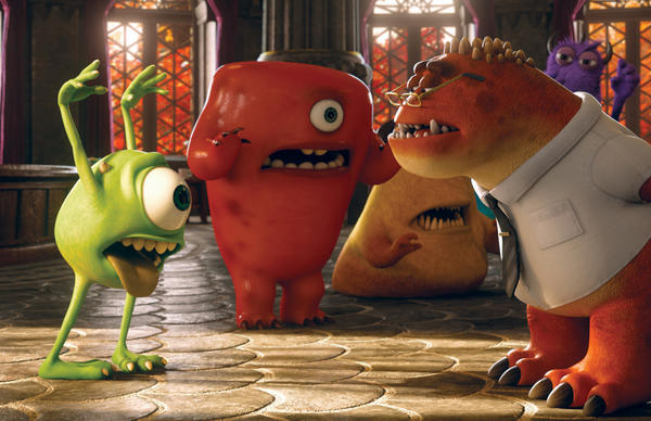 "Mike, voiced by Billy Crystal, left, and Professor Knight, voiced by Alfred Molina, right, in a scene from ""Monsters University."""