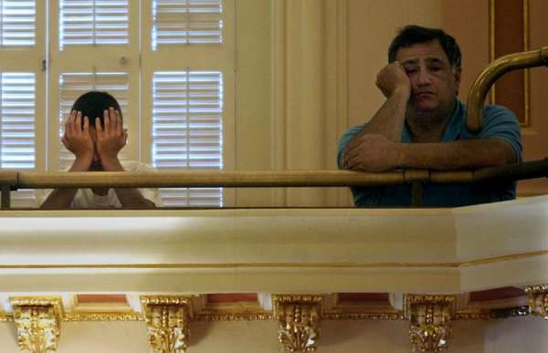 These visitors to the California state capitol building in Sacramento are learning a thing or two about boredom as they watch the Legislature pass a budget.