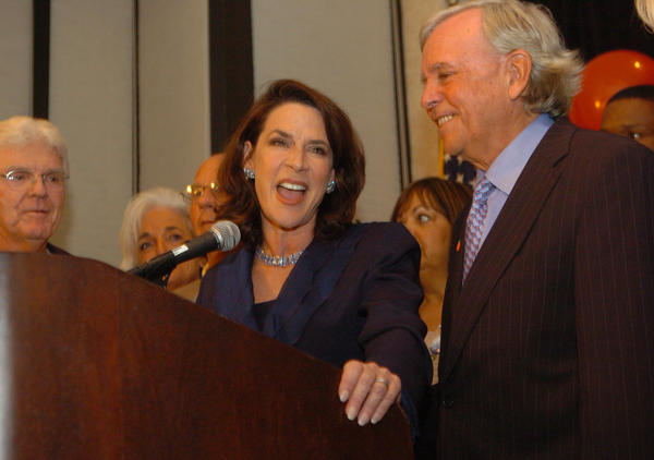 Katherine Harris talks to supporters after losing the mid-term elections at the Hyatt Resort in Sarasota, Fl, Tuesday evening, November 7, 2006. Her husband, Anders Ebbeson, is with her (R).