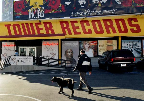 In 2004, Tower Records on the Sunset Strip was a recognizable landmark with its distinctive yellow and red signage and giant album cover posters.