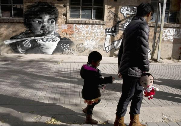 A woman and a child in Beijing. The Chinese government announced last week that it would ease the one-child policy to allow couples in which either partner is an only child to have a second baby.