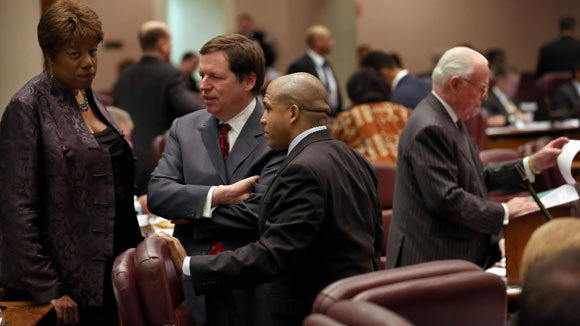 Aldermen Pat Dowell, from left, Joe Moore and Will Burns have a discussion n the City Council chambers in February.