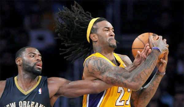 Jordan Hill grabs a rebound in front of New Orleans' Tyreke Evans during the Lakers' 116-95 win over the Pelicans on Nov. 12.