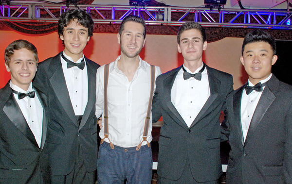 Randy Sage, center, who served as the evening's assistant director, with members of VMA's Gentleman's Octet Jake Miller, from left, Aaron Honda, Aram Krakirian and Daniel Choe.