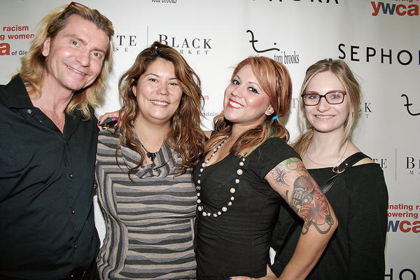 Makeovers That Matter CEO Michael John Derricott and hair stylists, from left, Janet Barajas, Quinn Garcia and Heather Andrews put the finishing touch on women veterans before their re-entry into the workforce.